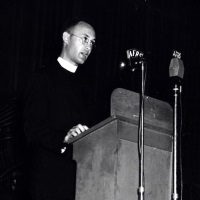 Close-up of Chaplain Yost speaking at a podium